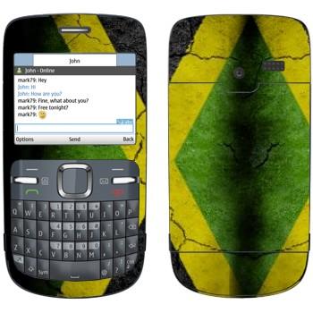 Виниловая наклейка «Флаг Ямайки на асфальте» на телефон Nokia C3-00