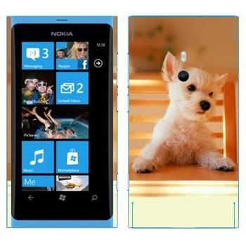 Виниловая наклейка «Щенок за столом» на телефон Nokia Lumia 800